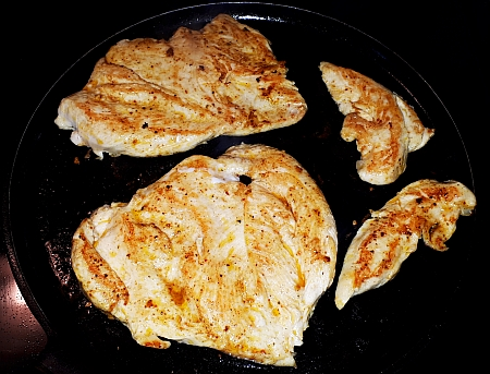 Cooking the chicken breasts for quesadilla