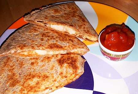 Chicken quesadilla with salsa.