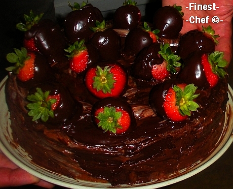 Chocolate cake with chocolate-dipped strawberries