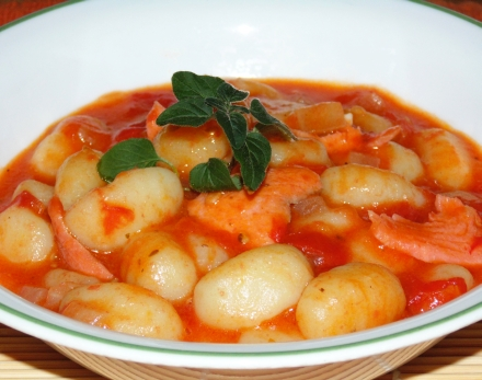 Gnocchi pasta with smoked salmon and tomato