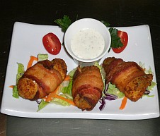 Jalapeno poppers stuffed with cream cheese bacon wrapped